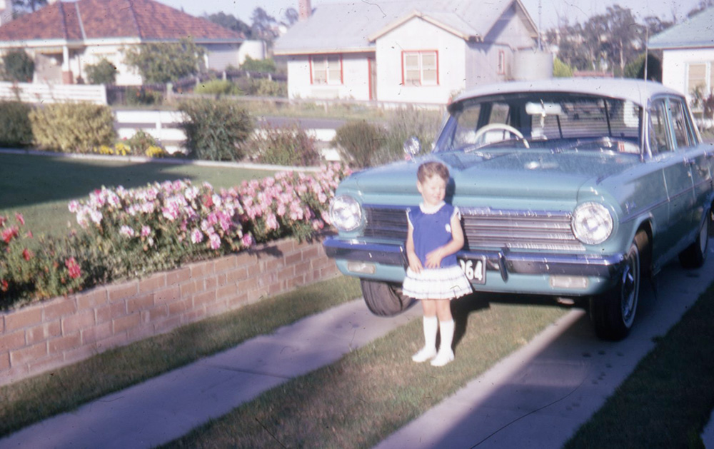 little girl in front of a holden
