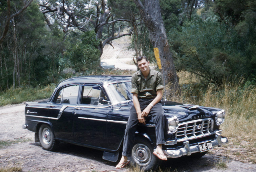 Sitting on a car in the bush