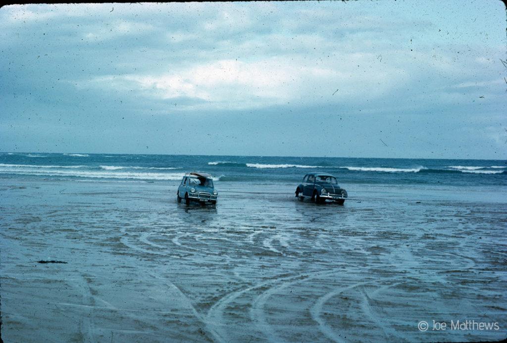 VW beetle and Mini on beach